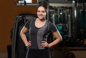 Young Brunet Woman Posing In The Gym — Foto Stock