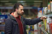 Young Man Shopping In The Supermarket — Stock Photo