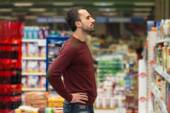 Handsome Young Man Shopping In A Grocery Supermarket — Stok fotoğraf