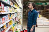Handsome Young Man Shopping In A Grocery Supermarket — Photo