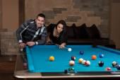 Couple Playing Billiard — Stockfoto