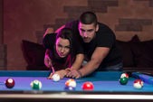 Couple In A Nightclub Playing Pool — Stock Photo