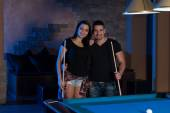 Smiling Happy Couple Playing Billiard — Stock Photo