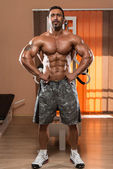 Muscular Man Flexing Muscles — Stock Photo