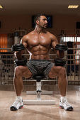 Bodybuilder Doing Heavy Weight Exercise For Shoulders — Stock Photo