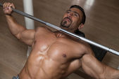 Bodybuilder Exercising Chest With Barbell — Stock Photo