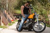 Bodybuilder And Motorcycle — Stock Photo