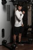 Young Man Exercising Biceps On Machine — Stock Photo