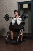 Handsome Man Doing Biceps Exercises In The Gym — Stock Photo