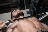 Young Man Exercising Chest With Barbell — Stock Photo