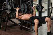 Young Man Doing Exercise For Chest With Barbell — Stock Photo