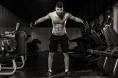Young Man Exercising Shoulders With Dumbbells — Stock Photo
