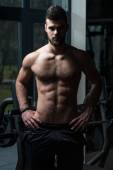 Young Handsome Man Posing In The Gym — Stock Photo