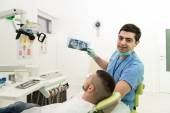 Dentist Holding X-Ray And Examse White Patient — Stock Photo