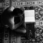 Arabic Muslim Man Reading Holy Islamic Book Koran — Stock Photo #67300467