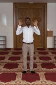 African Muslim Praying In Mosque — Stock Photo