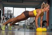 Woman Exercising Push Ups On Yellow Balls — Stock Photo