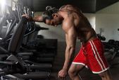 Bodybuilder Exercising Back With Dumbbell — Foto de Stock