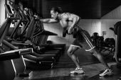 Bodybuilder Exercising Back With Dumbbell — Stock Photo