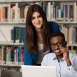 Students Using A Tablet Computer In A Library — Stock Photo #73724315