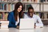 Couple Of Students With Laptop In Library — Stock Photo