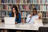 Young Students Using Their Laptop In A Library — Foto Stock