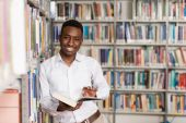 Happy Male Student With Book In Library — Stock Photo