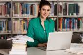 Happy Female Student With Laptop In Library — Stock Photo