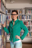 Happy Female Student With Book In Library — Stock Photo