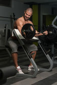 Bodybuilder Exercising Biceps With Barbell — Stock Photo