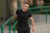 Young Man Is Streching Outdoors — Stockfoto