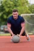 Young Man Exercising Push-Ups On Medicine Ball Outdoor — Stock fotografie