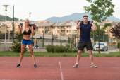 Group Of People Doing Bag Squat Exercise Outdoor — Stock Photo