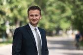 Portrait Of A Confident Businessman Outdoors In Park — Stock Photo