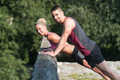 Young Couple Doing Push Ups Outdoor — Stock Photo