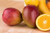 Citrus fruits and bananas — Stock Photo