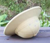 Pith helmet located on the painted bench. — Stock Photo