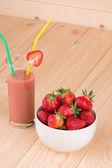 Strawberry milkshake on a wooden background. — Stock Photo