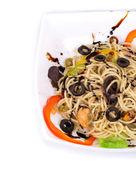 Seafood salad with spaghetti. Close up. — Stock Photo