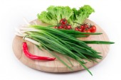 Onions and cherry tomatoes — Stock Photo