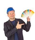 Worker showing paint palette. — Stock Photo