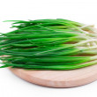 Spring onions on the wooden cutting board — Stock Photo #56461103