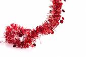 Christmas red tinsel with stars — Stock Photo