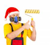 Worker in gas mask and santa hat — Stock Photo