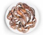 Raw shrimps on plate — Foto Stock