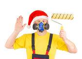 Worker in santa's hat — Stock Photo