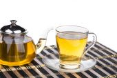 Teapot and cup with tea — Stock Photo