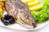 Grilled fish with vegetables. — Stock Photo