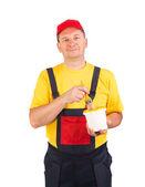 Escovas de trabalhador apresentando. — Fotografia Stock