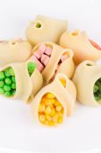 Pasta shells stuffed with vegetables and sausage. — Stock Photo